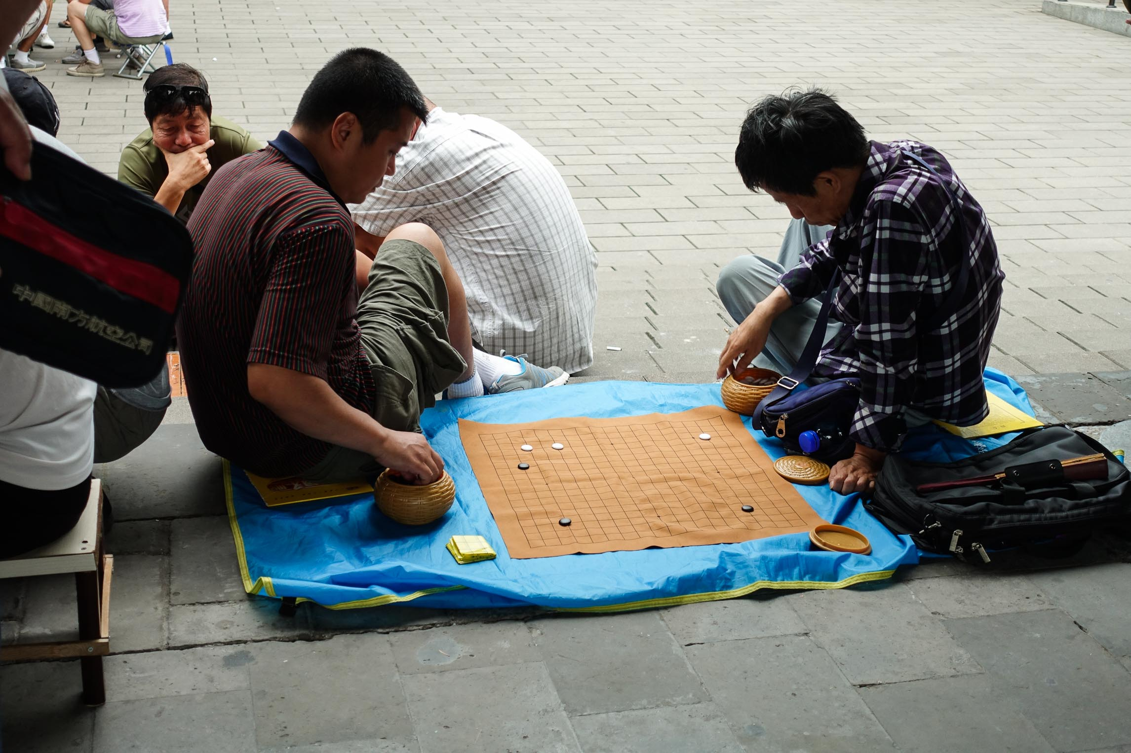 Local Chinese people playing Go in the Temple of Heaven gardens