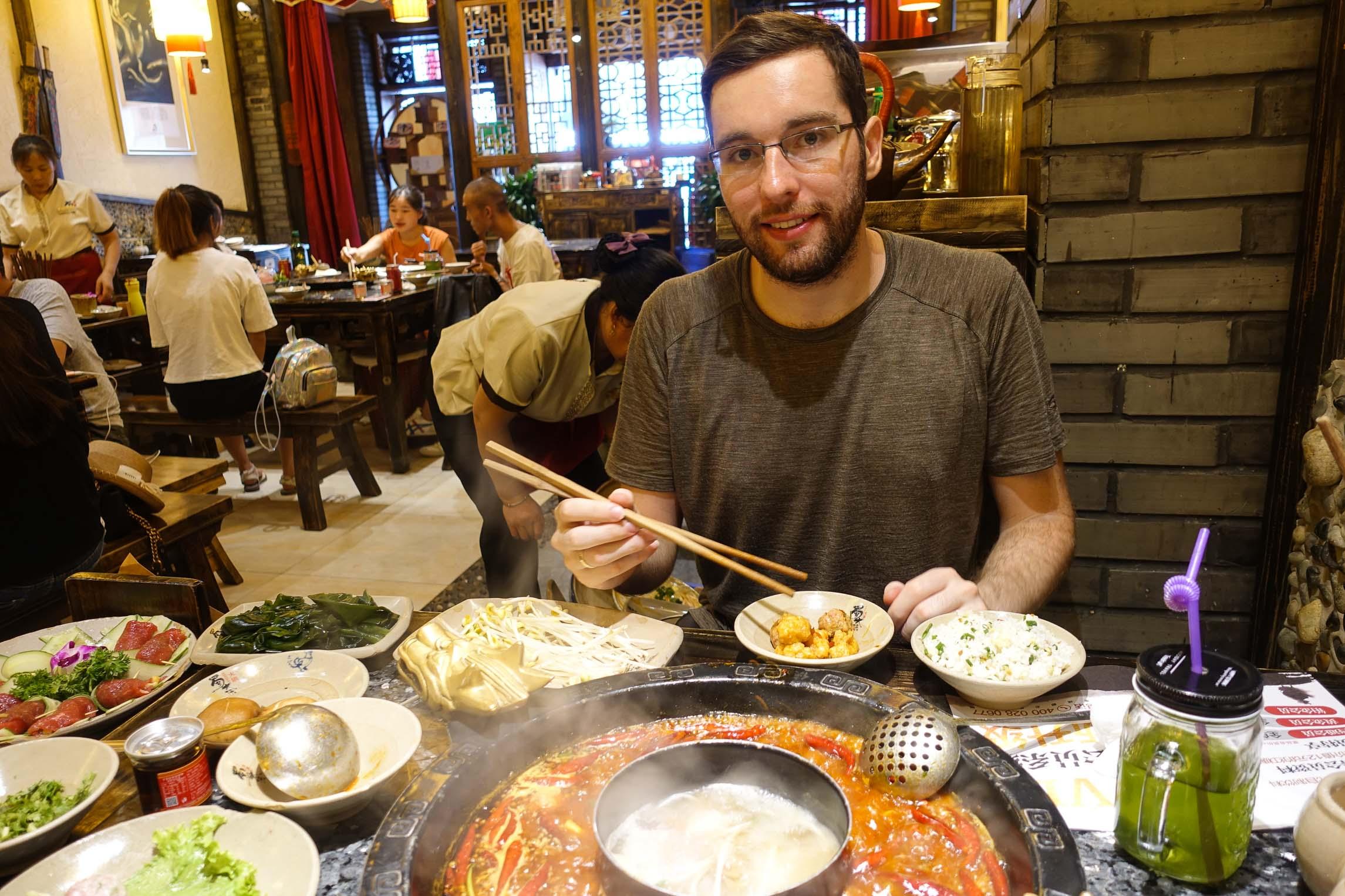 Ákos eating hot pot